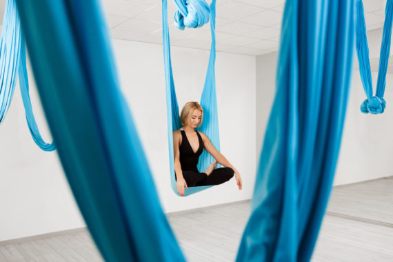 Young,Beautiful,Girl,Practicing,Aerial,Yoga,In,Gym.